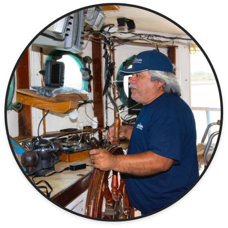 Boat Captain Drives His Ship