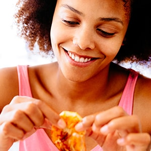 Woman eating shrimp for its many nutritional benefits