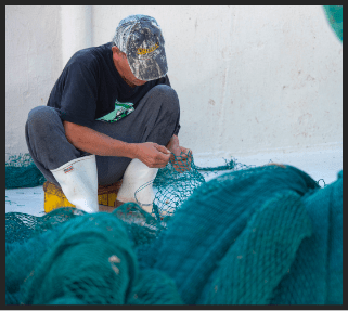 Worker weaving sustainable fish net